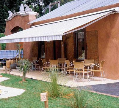 Dise o nuevos toldos premium en for Toldos para patios interiores