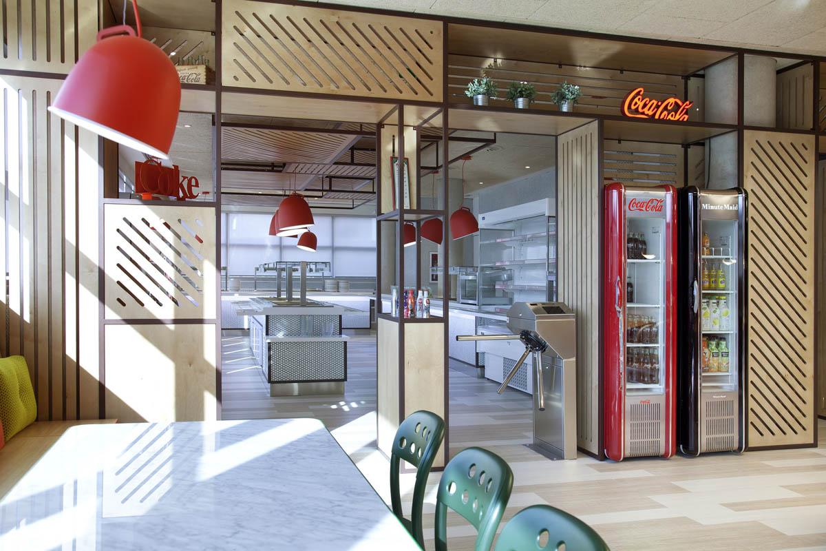 Y stone designs iluminan las oficinas centrales de for Las oficinas